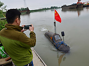 MAANSHAN, CHINA - APRIL 27: (CHINA OUT) <br /> <br /> Homemade Submarine <br /> <br /> Zhang Shengwu drives his homemade submarine in the river at Zhangdu village on April 27, 2016 in Maanshan, Anhui Province of China. 51-year-old Zhang Shengwu, who built a dock and sold building materials, used over 5,000 yuan (about 771 USD) make a submarine in two month in Maanshan. The 6-meter-long, 2 tons submarine was powered by a tricycle motor, and had no Oxygen supply system. The submarine could dove over one meter under water, and Zhang had obtained national patent for it on February in 2016.<br /> ©Exclusivepix Media
