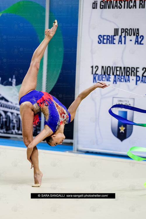 PADUA, ITALY - NOVEMBER 12 2016: Anna Rizatdinova of San Giorgio Desio performs with ribbon at the italian national rhythmic gymnastic championship. Her score in the apparatus is 18,600. Her team's score is 103,450 and ended up in first position.<br /> #SerieAdiritmica<br /> #ginnasticaritmica #rhythmicgymnastic #gymnast #sport #sportphotography