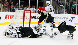 Dec 10, 2008; Newark, NJ, USA; New Jersey Devils center Travis Zajac (19) scores past Pittsburgh Penguins goalie Dany Sabourin (30) during the second period at the Prudential Center.