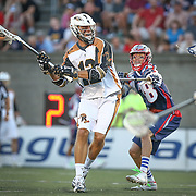 Justin Turri #12 of the Rochester Rattlers shoots the ball during the game at Harvard Stadium on August 9, 2014 in Boston, Massachusetts. (Photo by Elan Kawesch)