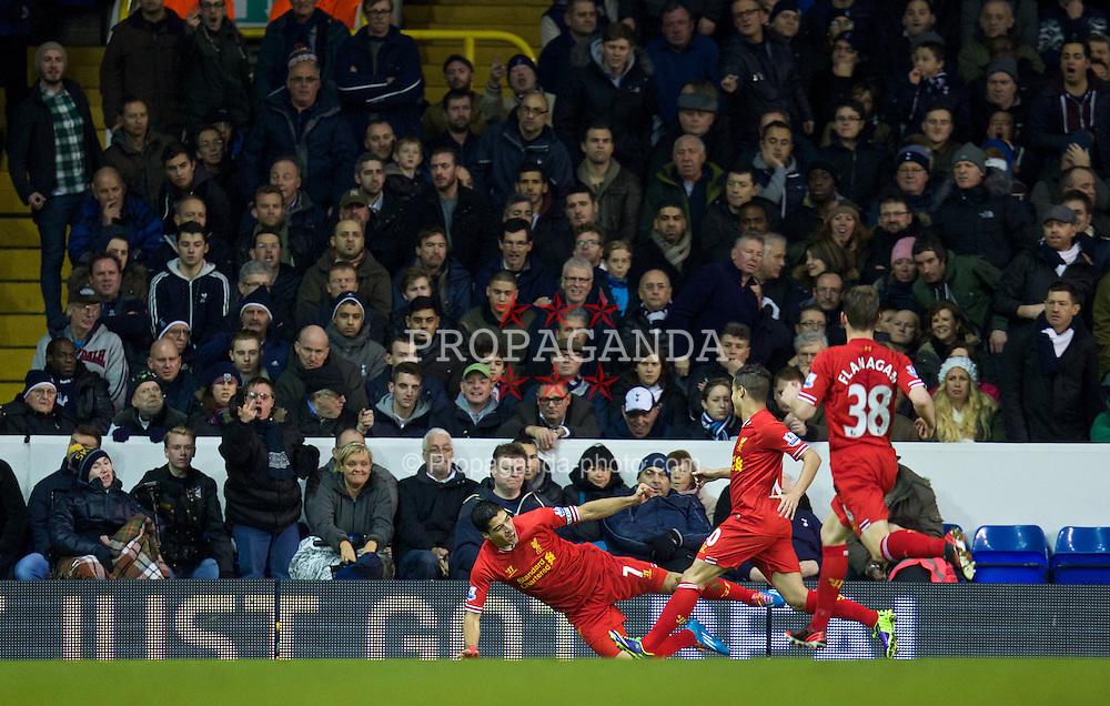LONDON, ENGLAND - Sunday, December 15, 2013: Liverpool's captain Luis Suarez celebrates scoring the first goal against Tottenham Hotspur during the Premiership match at White Hart Lane. (Pic by David Rawcliffe/Propaganda)
