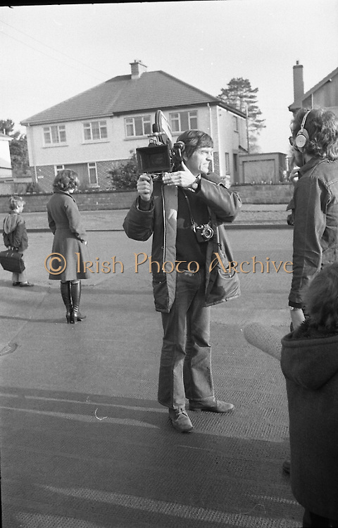 Liam Cosgrave Votes In General Election (E47).1973..28.02.1973..02.28.1973..28th February 1973..After sixteen consecutive years of Fianna Fail Government the Irish people went to the polls today to elect a new government. Mr Liam Cosgrave hoped that a coalition with Labour would oust the current office holders...Image shows the press preparing for the photo opportunity of Mr Liam Cosgrave casting his vote at Ballyroan School,Rathfarnham.