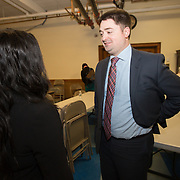 Boston City Councilor Josh Zakim speaks with Shaina Aubourg, a neighborhood liaison from The Mayor's Office, following a meeting regarding a new Mission Hill building development project at The Mission Church on January 22, 2015 in Boston, Massachusetts. (Photo by Elan Kawesch/The Times of Israel)