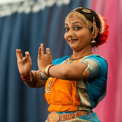 © Licensed to London News Pictures. 05/09/2015. Watford, UK.A dancer performs a classical dance on stage during the biggest Janmashtami festival outside of India at the Bhaktivedanta Manor Hare Krishna Temple in Watford, Hertfordshire.  The event celebrates the birth of Lord Krishna and the festival  includes music, dance, food, dramas and more. Photo credit : Stephen Chung/LNP