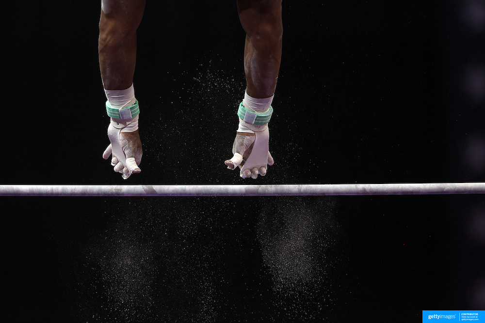 Hands grab for the Horizontal bar as chalk dust falls from the bar during the Senior Men Competition at The 2013 P&G Gymnastics Championships, USA Gymnastics' National Championships at the XL, Centre, Hartford, Connecticut, USA. 16th August 2013. Photo Tim Clayton