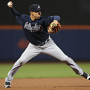 NEW YORK, NEW YORK - MAY 03:  Daniel Castro #14 of the Atlanta Braves makes an out from third base during the Atlanta Braves Vs New York Mets MLB regular season game at Citi Field on May 03, 2016 in New York City. (Photo by Tim Clayton/Corbis via Getty Images)