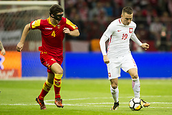 October 8, 2017 - Warsaw, Poland - Piotr Zielinski of Poland and Nikola Vukcevic of Montenegro during the FIFA World Cup 2018 Qualifying Round Group E match between Poland and Montenegro at National Stadium in Warsaw, Poland on October 8, 2017  (Credit Image: © Andrew Surma/NurPhoto via ZUMA Press)