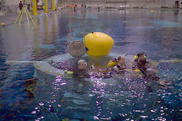 Stock photo of safety instructors in scuba gear in the pool at the NASA Neutral Buoyancy Lab in Houston Texas