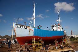 Fishing boat on slipway for repairs