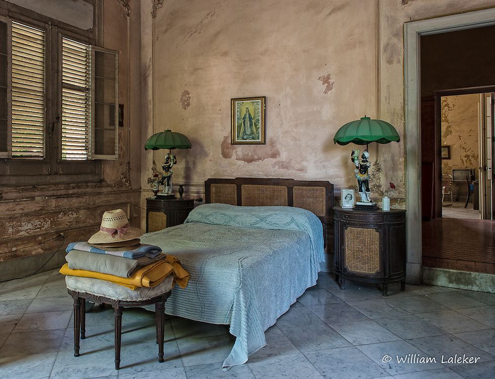A bedroom area appears virtually untouched from the period in a once glamorous 1920's home located in Havana's Vedado neighborhood