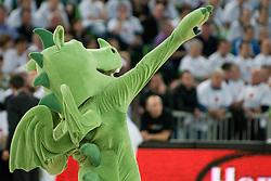 Official mascot of Union Olimpija dragon dancing during basketball match between KK Union Olimpija (SLO) and Power E. Valencia (SPA) in Group D of Turkish Airlines Euroleague, on November 17, 2010 in Arena Stozice, Ljubljana, Slovenia. (Photo By Matic Klansek Velej / Sportida.com)