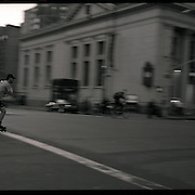 With space at a premium in the vast metropolis of Manhattan, New York City, locals find ways and means for pastime exercise and recreational activities as they go about their daily lives..A roller blade rider beats the lights in Midtown Manhattan on May 2, 2004. Photo Tim Clayton.