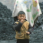 Many of the villagers of Wangjiazhai work with coal from selling to refining, digging and collecting.  Their homes and lifestyle are quite poor and coal seems to be part of it from being a source of income to be is used for heating and cooking.