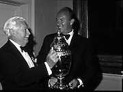 The Aga Khan hands over the new Nations Cup to the President of the Royal Dublin Society (RDS), Ballsbridge, Dublin. The trophy was first presented over 50 years earlier. The new cup is the 6th trophy to be presented for the international horse competition...1980-08-07.7th August 1980.07/08/1980.08-07-80..Photographed at the Royal Dublin Society...From Left:..Professor John Carroll..The Aga Khan