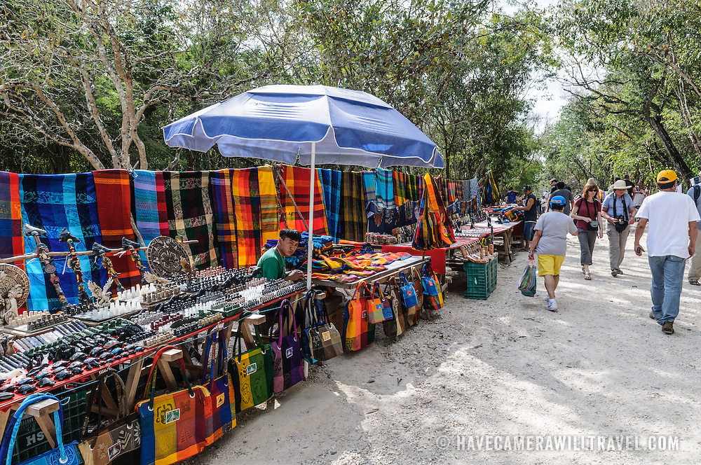 Market stalls selling local souvenirs and handicrafts to tourists visiting Chichen Itza Mayan ruins archeological site in Yucatan, Mexico.