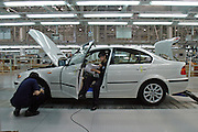 Chinese workers inspect a new BMW on an assemble line in a factory in Shenyang. The German luxury auto maker expects its vehicle sales in China to hit 22 thousand units in 2005, including imports. Last year (2004), BMW posted a 16 percent fall in vehicle sales in China to 15 thousand units, including imports. BMW makes its luxury sedans in China with local partner Brilliance China Automotive Holdings Limited.