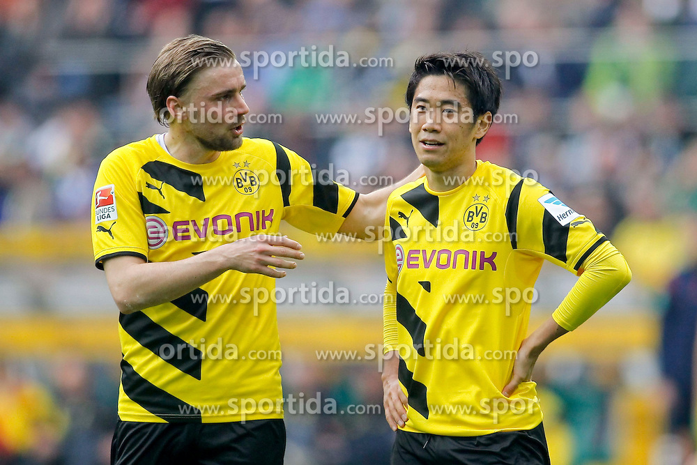 11.04.2015, Borussia Park, Moenchengladbach, GER, 1. FBL, Borussia Moenchengladbach vs Borussia Dortmund, 28. Runde, im Bild Marcel Schmelzer (Borussia Dortmund #29) im Gespraech mit Shinji Kagawa (Borussia Dortmund #7) // 15054000 during the German Bundesliga 28th round match between Borussia Moenchengladbach and Borussia Dortmund at the Borussia Park in Moenchengladbach, Germany on 2015/04/11. EXPA Pictures &copy; 2015, PhotoCredit: EXPA/ Eibner-Pressefoto/ Sch&uuml;ler<br /> <br /> *****ATTENTION - OUT of GER*****
