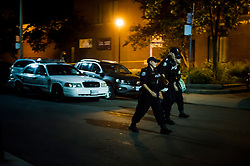 Police are seen securing a perimeter around a scene of mass casualty event in Toronto, ON, Canada, on Sunday, July 22, 2018. A young woman has been killed and 13 others injured in a shooting incident in Toronto, Canadian police say. The Sunday night shooting happened in the Danforth and Logan avenues area. The gunman died in an exchange of fire. Among those injured is a young girl, described as in a critical condition. Police are appealing for witnesses. Photo by Christopher Katsarov/ABACAPRESS.COM