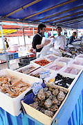 France, Paris, an outdoor, street food market Seafood stall