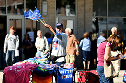 Outside a Hillary Clinton rally in suburban Philadelphia, PA, a vendor offers merchandise in support of the Democratic presidential candidate.