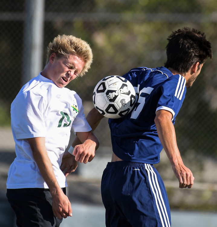 11/4/163:12:16 PM --- soccer ----<br /> <br /> Golden West College's Calvin Cruz, left, and Fullerton College's Leonardo Paredes battle for possession of the ball during a regular season match on Nov. 5, 2016. Golden West College would defeat Fullerton 2-0 adding another win to their current record of 12-0-6.<br /> <br /> Photo by Claire Rounkles, Sports Shooter Academy