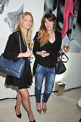 Left to right, SARAH MILNE and ANNA BANCE at a party hosted by Ines de la Frassange and Bruno Frisoni for Roger Vivier to launch the Roger Vivier book held at The Saatchi Gallery, London on 24th April 2013.