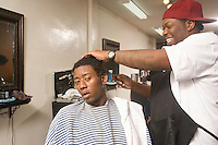 A young man having his hair done in the barbers