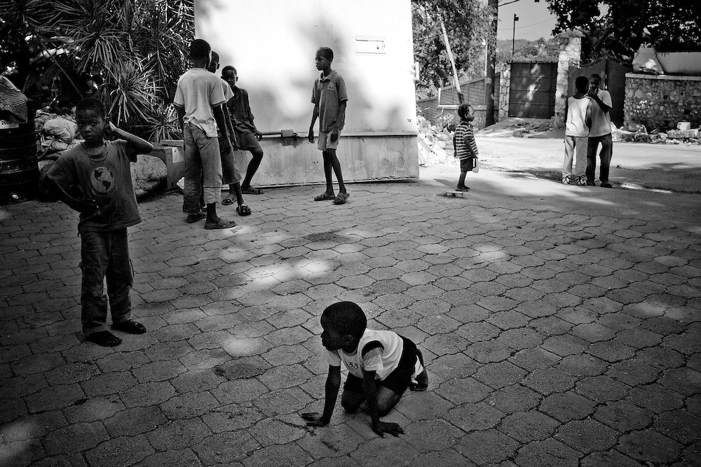 Children play in the yard where they are sleeping after their homes were destroyed by the earthquake in Port-au-Prince, Haiti.