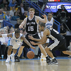 17 December 2008:  New Orleans Hornets guard Chris Paul (3) and San Antonio Spurs guard Tony Parker (9) scramble for a loose ball during a 90-83 victory by the New Orleans Hornets over the San Antonio Spurs at the New Orleans Arena in New Orleans, LA..