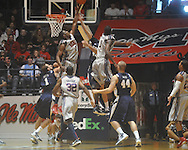 "Ole MIss forward Reginald Buckner (2)  blocks East Tennessee State's Adam Sollazzo (43) shot at the C.M. ""Tad"" Smith Coliseum in Oxford, Miss. on Saturday, December 18, 2010. Ole Miss won 71-50."