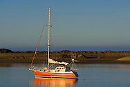 Sailboat anchored in the still calm water of Morro Bay, California