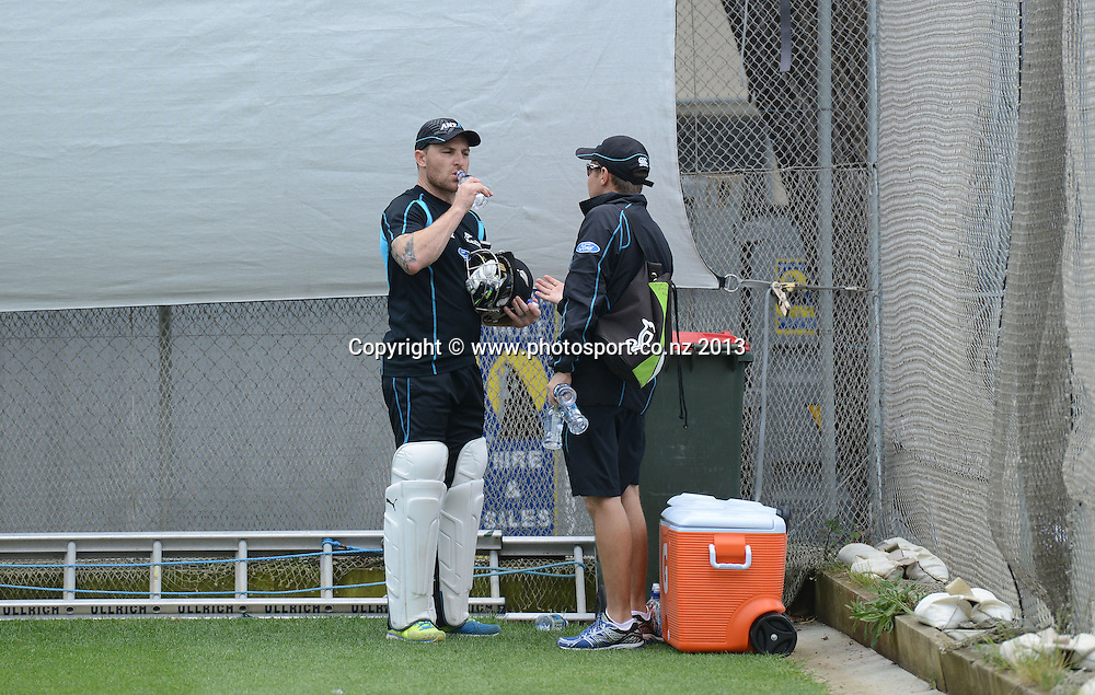 New Zealand Cricket captain Brendon McCullum talks to coach Mike Hesson during a training session in the nets ahead of the 2nd test match against the West Indies starting at the Basin Reserve in Wellington tomorrow. Tuesday 10 December 2013. Photo: Andrew Cornaga / www.Photosport.co.nz