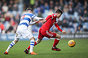 Queens Park Rangers midfielder Josh Scowen and Nottingham Forest midfielder Joe Lolley during the EFL Sky Bet Championship match between Queens Park Rangers and Nottingham Forest at the Loftus Road Stadium, London, England on 24 February 2018. Picture by Toyin Oshodi.