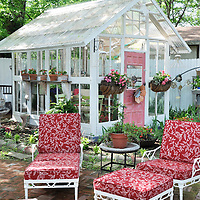 Vintage garden: Patio in front of shed made from architectural salvage