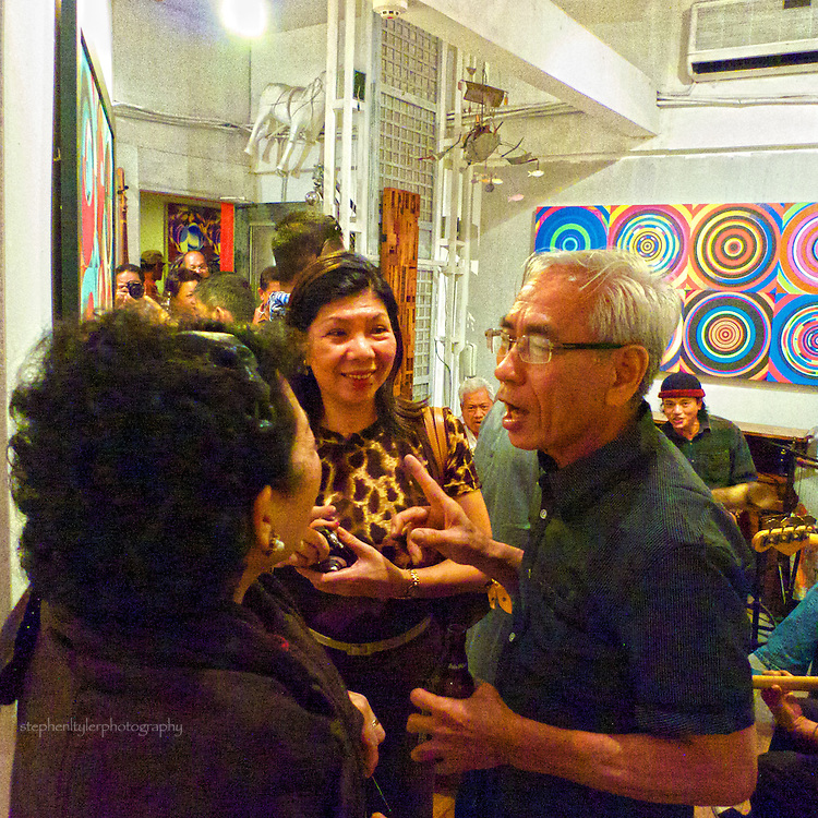 """Master Digital Artist Rodolfo Samonte with admirers at the opening night of his """"New Work"""" exhibition held in Ross Capili's GalerieOne Workshop in Makati City."""