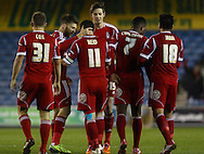 Picture by David Horn/Focus Images Ltd +44 7545 970036<br /> 03/12/2013<br /> Andy Reid of Nottingham Forest (3rd left) celebrates with team mates after scoring his team's first goal to make it 1-1 during the Sky Bet Championship match at The Den, London.