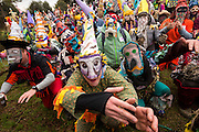 Revelers beg a family for food donations during the Faquetigue Courir de Mardi Gras chicken run on Fat Tuesday February 17, 2015 in Eunice, Louisiana. The traditional Cajun Mardi Gras involves costumed revelers competing to catch a live chicken as they move from house to house throughout the rural community.