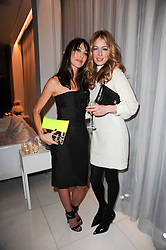 Left to right, TAMARA MELLON and CAT DEELEY at a party to celebrate Lancome's 10th anniversary of sponsorship of the BAFTA's in association with Harper's Bazaar magazine held at St.Martin's Lane Hotel, London on 19th February 2010.