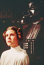 December 27, 2016 - File - CARRIE FRANCES FISHER (October 21, 1956 - December 27, 2016) was an American actress, screenwriter, author, producer, and speaker. She was known for playing Princess Leia in the Star Wars films. Fisher was also known for her semi-autobiographical novels, including Postcards from the Edge, and the screenplay for the film of the same name, as well as her autobiographical one-woman play, and its nonfiction book, Wishful Drinking, based on the show. Her other film roles included Shampoo (1975), The Blues Brothers (1980), Hannah and Her Sisters (1986), The 'Burbs (1989), and When Harry Met Sally (1989). Pictured: April 29, 2014 - Original Star Wars actors Harrison Ford, Carrie Fisher and Mark Hamill will feature in Star Wars: Episode VII, the latest film in the franchise. Other actors confirmed are Andy Serkis and Max von Sydow, alongside relative newcomers John Boyega and Daisy Ridley, both of whom are British. Episode VII will start shooting at Pinewood Studios, near London, in May. Anthony Daniels, Peter Mayhew and Kenny Baker will also return as C-3PO, Chewbacca and R2-D2 respectively. PICTURED: Star Wars: Episode VI - Return of the Jedi Movie still. RELEASE DATE: May 25, 1977  PICTURED: CARRIE FISHER as Princess Leia Organa and DAVID PROWSE as Darth Vader. (Credit Image: © Lucas Films/Entertainment Pictures/ZUMAPRESS.com)