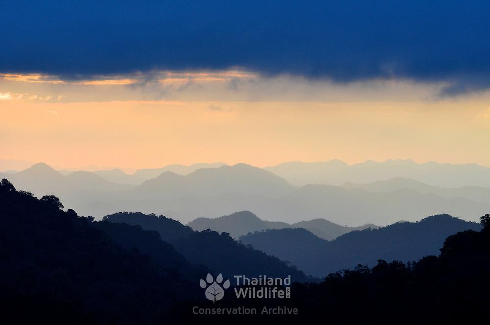 View of the rolling mountain peaks of Kaeng Krachan National Park at daw. Kaeng Krachan is Thailand.'s largest National Park.