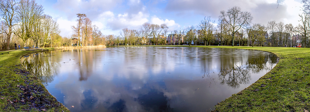 "Pond panoramic landscape photo in Vondelpark, Amsterdam. Is a public urban park of 47 hectares (120 acres), opened in 1865 and originally named the ""Nieuwe Park"" and is a favorite place for rest and walking to residents and tourists. Yearly, the park has around 10 million visitors."