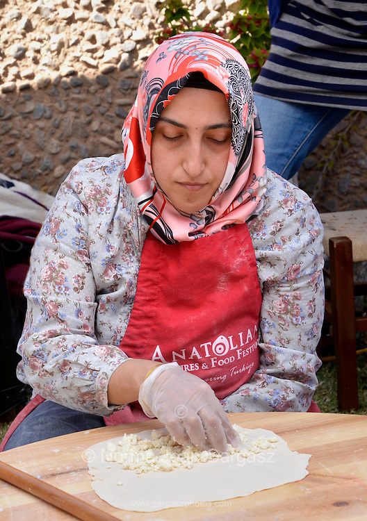 Sevgi Ginglli makes traditional gozleme, a rolled dough folded, filled with cheese or meat, then grilled, at the Turkish booth at Tucson Meet Yourself, an annual festival celebrating culture and diversity in Tucson, Arizona, USA.