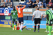 Karleigh Osborne of AFC Wimbledon sees his 2nd yellow during the Sky Bet League 2 match between Luton Town and AFC Wimbledon at Kenilworth Road, Luton, England on 26 September 2015. Photo by Stuart Butcher.