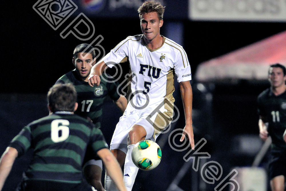 2013 November 08 - FIU's Marvin Hezel (5).   <br /> Florida International University fell to Charlotte, 3-0, at FIU Soccer Field, Miami, Florida. (Photo by: www.photobokeh.com / Alex J. Hernandez) This image is copyright PhotoBokeh.com and may not be reproduced or retransmitted without express written consent of PhotoBokeh.com. &copy;2013 PhotoBokeh.com - All Rights Reserved