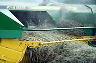 Close up of baler baling hay