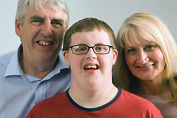 Parents with their teenage son who has Down's Syndrome,