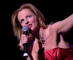 """""""Happy Birthday"""" and Gregorys Girl Claire Grogan of Altered Images on Tour with<br /><br />Steve Starnge (Visage)<br />The Belle Stars<br />Dollar<br />Kim Wilde<br />The Human League<br />Play on the Here and Now  Christmas Party Tour at Sheffields Hallam FM Arena Friday 13th December 2002<br /><br />[#Beginning of Shooting Data Section]<br />Nikon D1 <br />2002/12/13 21:00:11.1<br />JPEG (8-bit) Fine<br />Image Size:  2000 x 1312<br />Color<br />Lens: 80-200mm f/2.8-2.8<br />Focal Length: 125mm<br />Exposure Mode: Manual<br />Metering Mode: Spot<br />1/200 sec - f/2.8<br />Exposure Comp.: 0 EV<br />Sensitivity: ISO 800<br />White Balance: Auto<br />AF Mode: AF-S<br />Tone Comp: Normal<br />Flash Sync Mode: Not Attached<br />Color Mode: <br />Hue Adjustment: <br />Sharpening: Normal<br />Noise Reduction: <br />Image Comment: <br />[#End of Shooting Data Section]"""