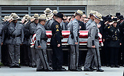 The casket of slain New York state trooper, Joel Davis, is carried out of the Magrath Sports Complex at Fort Drum, N.Y., by law enforcement personnel, during Davis's funeral service, Saturday, July 15, 2017. Trooper Davis, 36, was fatally shot Sunday, July 9, 2017, while responding to reports of gunfire on a couple's property in the town of Theresa, N.Y. Police say a Fort Drum soldier, Staff Sgt. Justin Walters, fatally shot his 27-year-old wife before shooting Davis. Walters, who served two combat tours in Afghanistan, has been charged with two counts of murder. Fort Drum is the home of the Army's 10th Mountain Division. <br /> (AP Photo/Heather Ainsworth)