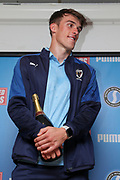 AFC Wimbledon defender Ryan Delaney (21) receiving man of match award during the EFL Sky Bet League 1 match between AFC Wimbledon and Bristol Rovers at the Cherry Red Records Stadium, Kingston, England on 21 September 2019.