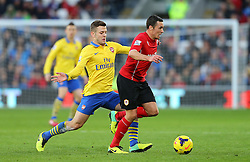 Cardiff City's Don Cowie skips away from Arsenal's Jack Wilshere  - Photo mandatory by-line: Gary Day/JMP - Tel: Mobile: 07966 386802 30/11/2013 - SPORT - Football - Cardiff - Cardiff City Stadium - Cardiff City v Arsenal - Barclays Premier League